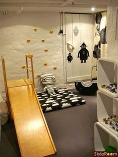 Love the climbing wall with an old mattress.