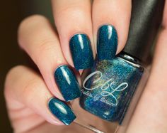 Colors by Llarowe Winter 2015 - Peacock Parade is a deep blue toned teal holographic. Swatch by @somarvellous on Instagram.