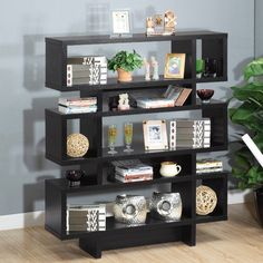 Hokku Designs Celio Three-Tier Bookcase / Display Cabinet in Black  This is a pain to put together, but it looks great. The shelves aren't very tall though, so somethings really do have to lay flat. The entire piece is tall though and very heavy.