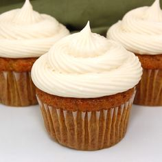 Carrot Cake Cupcakes with Cream Cheese Frosting - modify using coconut oil and rum soaked raisins.