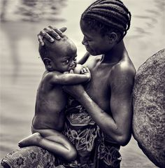 This image almost brought me to tears the first time I saw it. Something I had seen many times in Africa. The malnourished mother trying to nourish her child in a continent and lands of plenty yet with people living in poverty    God bless and restore Africa!