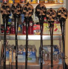 DIY skull tiki torches. Would be cute for anyone in a warmer climate where you can actually have a Halloween party outdoors.