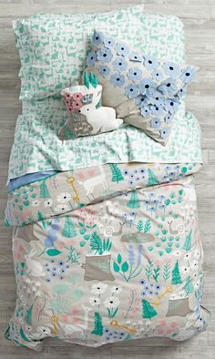 Deep in a mystical forest, we heard tales of a nature kids bedding set featuring a colorful, printed woodland scene complete with animals, flowers and more. Kids Bedding Sets, Toddler Bedding Girl, Girl Bedding, Little Girls Bedding Sets, Toddler Rooms, Natural Bedding, Cozy Bed, Little Girl Rooms, Kid Spaces