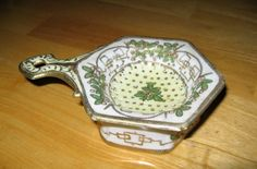 Antique Nippon Tea Strainer and Bowl Hand Painted Nippon Porcelain Tea Strainer and Dish  Ca 1891. $35.00, via Etsy.