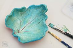 These clay leaf dishes are simple project you can do anytime throughout the year using air dry clay to mold them and paint to decorate.