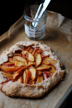Rustic tart.  There's nothing quite as lovely as a rustic apple tart.  Pair it with a Belgian linen tablecloth and peacock blue napkins.