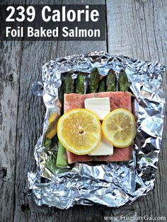 Easy 239 calorie baked salmon recipe with asparagus. The best part? This 30-minute recipe requires zero cleanup since the salmon is baked in foil pouches. Oven @ 400