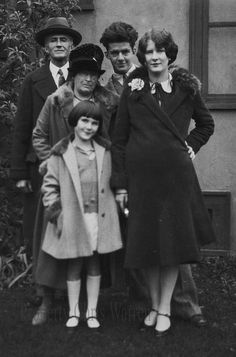 Three Generations pose in the side yard, 1930s, by ChrisWarren1956, via Flickr /// check out that hair--wow!