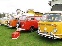 yellow and orange campervans by notputtingupshelves, via Flickr