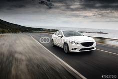 """Laden Sie das lizenzfreie Foto """"Speed Car"""" von Kurmyshov zum günstigen Preis auf Fotolia.com herunter. Stöbern Sie in unserer Bilddatenbank und finden Sie schnell das perfekte Stockfoto für Ihr Marketing-Projekt!"""