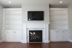 Project complete. Shaker style fireplace surround with shaker cabinets and bookshelves. The built-ins are complete.