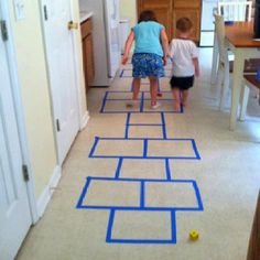 Rainy day activity: indoor hopscotch!  Painters tape comes right off once the kids are done :)