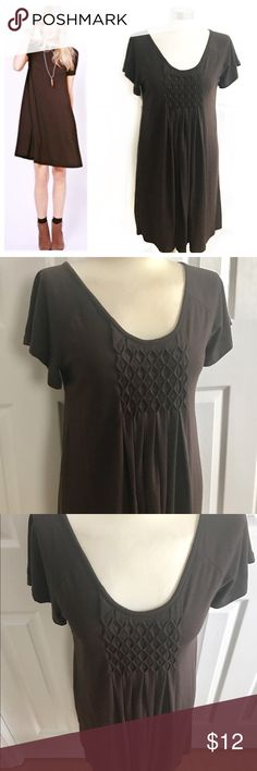 Serene Brown Tshirt Dress Comfy shortsleeve t-shirt dress with design on chest. Dark brown. 45% rayon 45% polyester 10% spandex. Stretch to fabric. Not fitted. Also could work for a medium. Some general pilling from normal wear. Priced accordingly. Offers welcome. serene Dresses