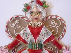 "#2 of 3 Spirit Of Mrs. Claus Angel Ornament. Chart Pack Includes: perforated paper, size 11 seed beads, beading needle, charts with instructions to make ornament. approx 5.5"" x 8"". Size 24Tapestry Needle, DMC Floss & Memory Thread, Kreinik #8 Fine Metallic Braids and 1/8"" Metallic Ribbons. (Not Included - dimensional wings pattern for fabric. Could stitch MRs C angel on fabric using perforated paper charts BUT you have to create own wings for fabric. These wings don't translate to fabric.)"