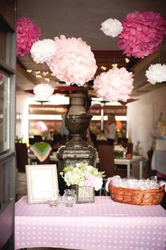 London's pink baby shower with tissue poms over the entry table