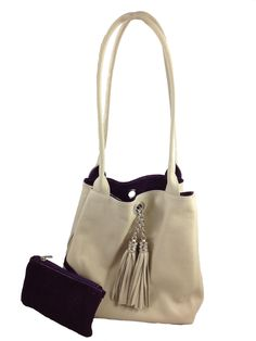 Lyn, Reversible Italian leather handbag. Cream leather/purple suede