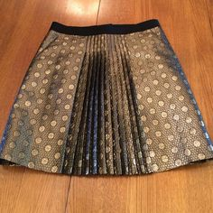 SALE! Metallic J Crew Polka Dot Skirt Fabulous J Crew Gold Metallic and Black Skirt. This skirt has side front pockets and knife pleats centered in the front. This is missing the size and care tag but here are the measurements:  Flat waist: 15.5, Hip: 19.5, Length: 19.75 J. Crew Skirts A-Line or Full