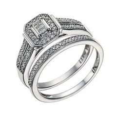 ****If i dont have tbis ring set my life will forever be incomplete!!! **** Styled with a vintage vibe, this elegant 9ct white gold bridal ring set features a sparkling six stone diamond princessa ring with diamond set shoulders, and a half diamond set wedding band. Both are certain to be treasured for many years.