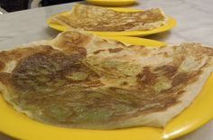Roti with Coconut, Onion and Chili   These flat breads are best made with freshly grated coconut, which is often sold in Asian shops. #roti #malaysia #singapore #breads #recipe #coconut #chili
