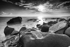 """Sunny Rocky Beach - Feel free to visit my website and see more of my works.   <a href=""""http://www.sunrisedawn.photography"""">www.sunrisedawn.photography</a>  A monochromatic long exposure seascape shot of a rocky beach on a sunny afternoon in Pintung County, Taiwan."""