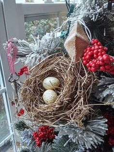 Add a bird's nest to a Christmas tree for a natural look. See more at http://www.diybeautify.com