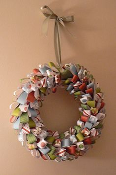 Looped wrapping paper wreath. Very easy to make but very time consuming cutting the wrapping paper into strips.