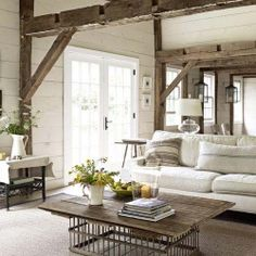 This living room employs clean, modern touches in order to enliven an aged farmhouse interior.