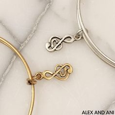 UPBEAT. NOSTALGIC. SOULFUL. #banglespotlight #sweetmelody #banglesthatbenefit #charmsthatgiveback #bangles #gold #silver #ALEXANDANI #withlove #CHARITYBYDESIGN #>>> Shop Sweet Melody by clicking the link in our profile!