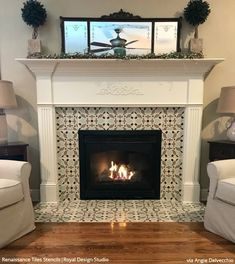 Sizzling Stencil Style: Paint Your Fireplace Tiles - 14 DIY Decorating & Renovation Ideas with Tile Pattern Stencils for Painting - Royal Design Studio Paint Fireplace Tile, Tile Around Fireplace, Fireplace Tile Surround, Fireplace Redo, Farmhouse Fireplace, Fireplace Remodel, Fireplace Surrounds, Fireplace Design, Painted Fireplace Mantels
