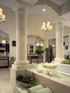 This luxurious neoclassic bathroom in Santa Ana Heights, Calif., boasts a gigantic Roman tub, a flat screen TV with retractable art, custom chandeliers and shagreen front vanity cabinets with durable Caesarstone counter tops. Dream Bathrooms, Beautiful Bathrooms, Luxurious Bathrooms, Bathroom Shop, Bathroom Ideas, Bathroom Images, Design Bathroom, Bathroom Faucets, Bathroom Interior