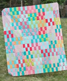 Bust out your brightest jelly rolls, because you won't be able to resist making this colorful quilt! Scrappy Quilt Patterns, Jelly Roll Quilt Patterns, Modern Quilt Patterns, Jellyroll Quilts, Scrappy Quilts, Baby Quilts, Fabric Remnants, Fabric Scraps, Buy Fabric