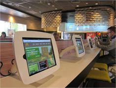 "McDonald's is testing a more family-friendly restaurant design with new technologies in the United Kingdom and Germany, the chain said. Self-order kiosks, digital-order information displays, dining room computer stations for consumers and a motion-sensitive gaming table are part of the so-called ""Spirit of Family"" design, according to U.K. representatives of the Oak Brook, Ill.-based McDonald's Corp."