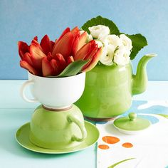 Tea Time Flower Display- Red tulips & white roses are awe-inspiring inside a stacked cup & kettle. Using 2 different colors adds interest, while the matching green dishes keep the display cohesive.