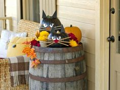 Black Cat Pumpkins in Our 50 Favorite Halloween Decorating Ideas from HGTV