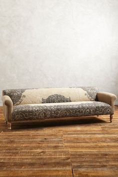 This is a gorgeous couch. Maybe I could turn the green couch into something similar... Dhurrie Sofa - anthropologie.com