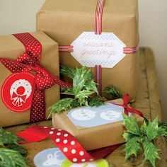 Use vintage paper coasters, old holiday cards and craft ribbons for these delightful gift wrapping. The sprig of green adds gorgeous contrast!