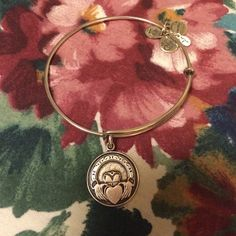 Silver Finish Alex & Ani Claddagh Bracelet Preloved as seen in 3rd picture but still has a lot of life left  it has a rustic look to it  ⛔️ NO TRADES, NO PAYPAL, NO MERCARI, NO HOLDS ⛔️ smoke free, pet free home  let me know if you have other questions  PLEASE MAKE OFFERS THROUGH THE OFFER BUTTON. Alex & Ani Jewelry Bracelets