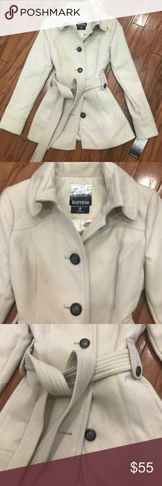 Kensie Cream Coat NWT Never worn! Comes with extra buttons. Lined inside. Button detail with waist tie. Kensie Jackets & Coats