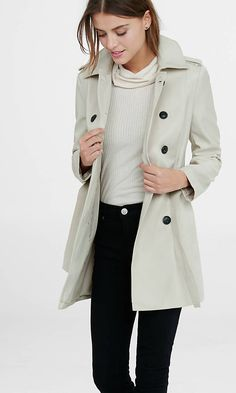A flattering, feminine spin on the menswear classic. Marbled, dome buttons and timeless trench coat details like a removable sash with trapunto stitching and double breasted front give this coat all the bells and whistles.