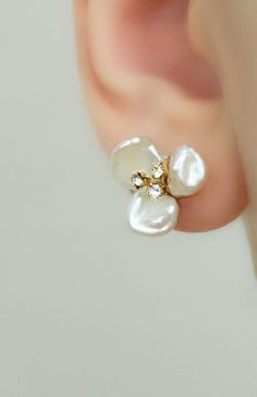 These beautiful stud earrings are made with silvery white colored freshwater pearls, and tiny gold rhinestones. They would be a beautiful