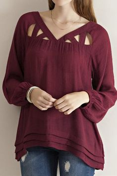 Solid guise cutout detail blouse featuring pintuck detail on hem. V-neckline. Elasticized sleeve cuff. Sheer. Woven. Lightweight. 65%RAYON 35%POLYESTER. You are purchasing the Burgundy color, grey is