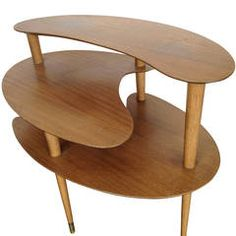 Table top shapes are good. Switch out some or all legs for vintage objects. Freestanding displayer.