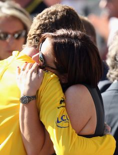 PARIS, FRANCE - JULY 22: Bradley Wiggins of Great Britain and SKY Procycling celebrates with his wife Cath after the twentieth and final stage of the 2012 Tour de France, from Rambouillet to the Champs-Elysees on July 22, 2012 in Paris, France. (Photo by Bryn Lennon/Getty Images)