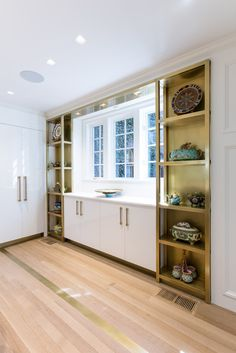 Custom Brass Shelves in the Kitchen- display your fine china like art in a gallery.