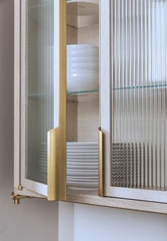 Amuneal Collector's Shelving   CSU #kitchen; brass, bleached oak, ribbed glass