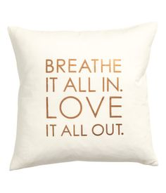 White/copper. Cushion cover in cotton twill with metallic printed text at front. Concealed zip.