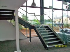 Architectural Staircase with Glass Balustrade