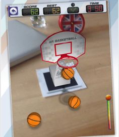 ARBasketball: Must See toBelieve! -> I've shared some apps that seem too good to be true and ARBasketball – Augmented Reality Basketball Game is definitely one of them. AR stands for Augmented Reality, and that's where the basketball hoop comes in. Download the app to your iPad, print out the PDF file on their website and hold your iPad over the piece of paper. A virtual basketball hoop will pop off the page and you can shoot baskets straight from your iPad.