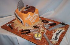 Father's Day 2007 - For Dad, and Hubby, who are wanna be carpenters, and SIL, who is a Physician at Gateway Hosp/ER..  Fondant cake w/chocolate tools and fondant decorations.  Vanilla wafer sawdust/chocolate  wood shavings. Thanks candy177 who did the original cake, for the idea.
