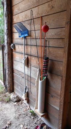 We continue to make progress on getting the barn sorted out. Last weekend, hubby worked on hanging tools like shovels, rakes, broomsetc... that have long handleswith these homemade PVC tool hange...